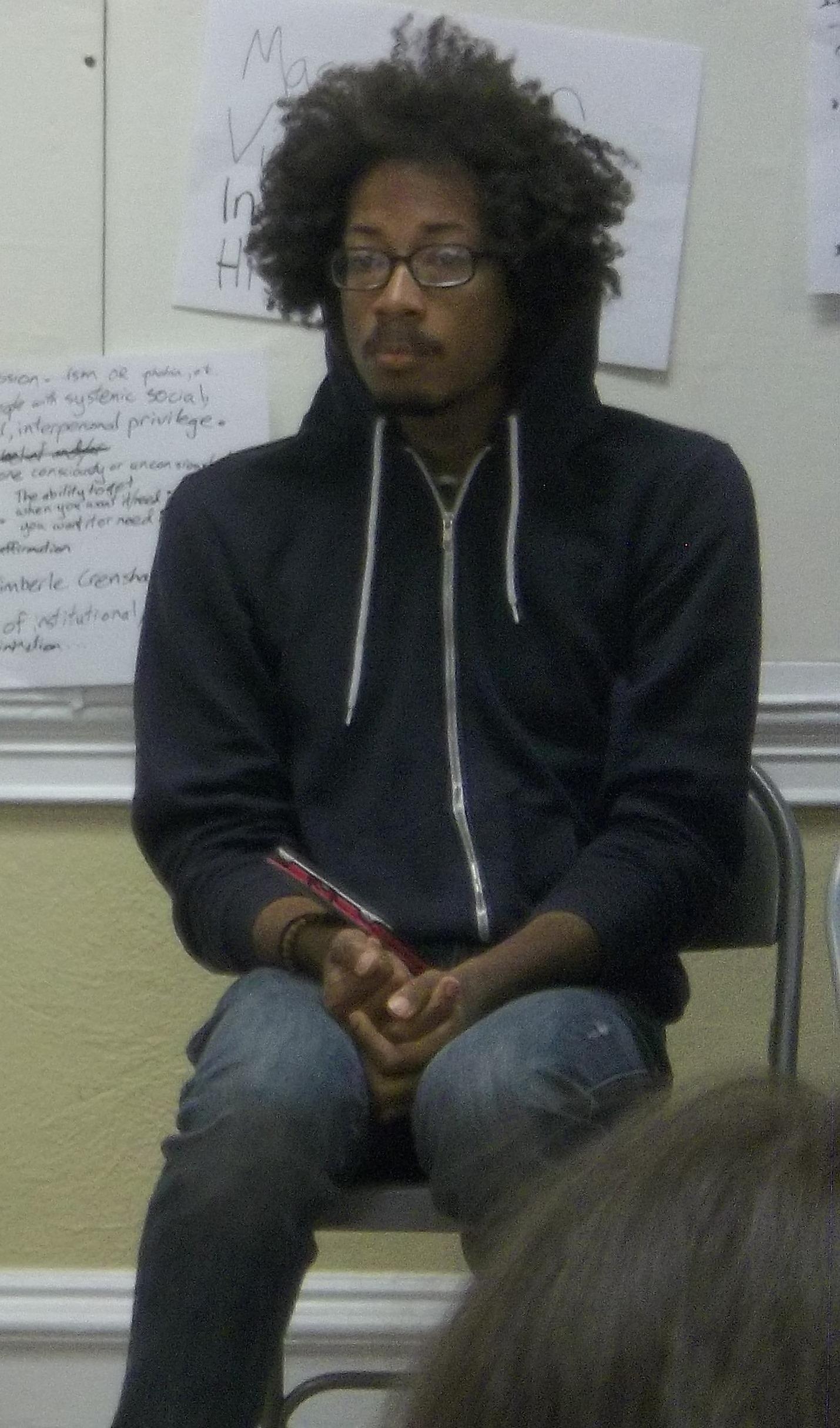 Malik Listening Intently as He Facilitates